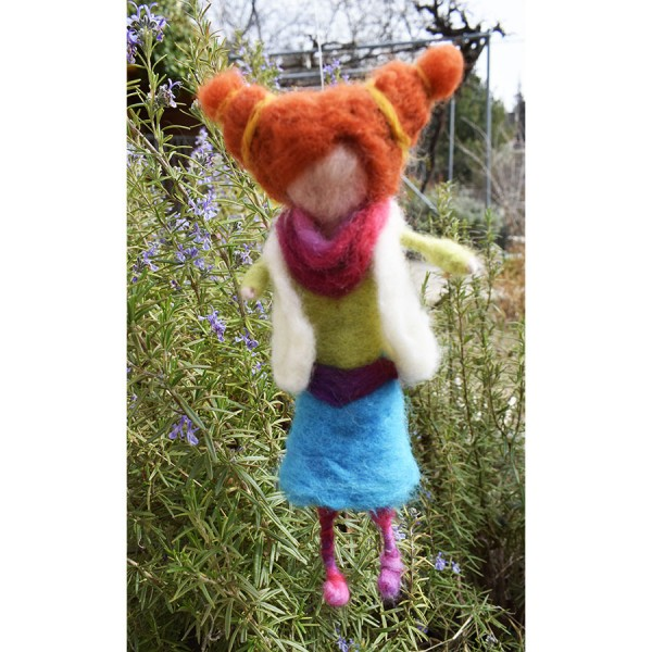 Waldorf doll with pigtails .