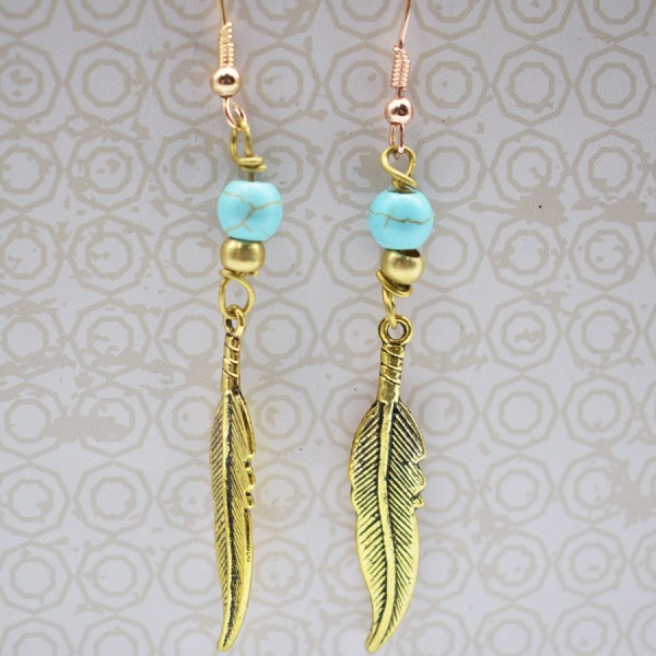 Handmade turquoise earrings with brass feather